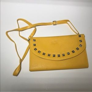 Yellow clutch over the shoulder bag
